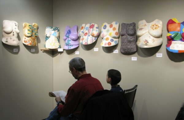 Boys sketching the sculptures at the Beautiful Women Project Exhibit
